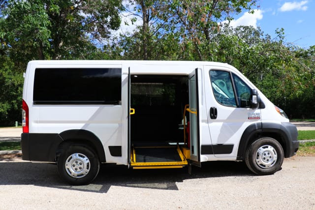 mobility van with powered ramp and doors parked in parking lot