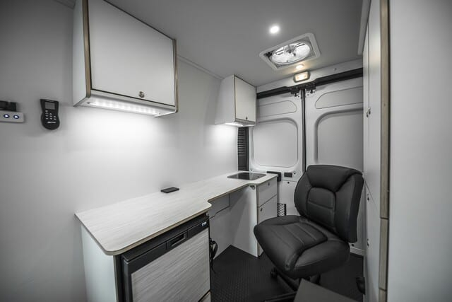 Mobile medical clinic in Ford Transit 148 Wheelbase, Single Rear Wheel, High Roof Model. Use for door to door health assessments and vaccinations. Includes mobile office and patient exam bed.