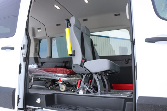 Removeable seats and stretcher inside a Ford Transit medical transportation wheelchair van by MoveMobility