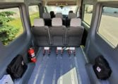 MoveMobility Ford Transit mobility van with six removeable AMF Bruns seats, AutoFloor flexible seating system, large windows, rear heat and air conditioning, two wheelchair positions, braunbility rear entry hydraulic lift