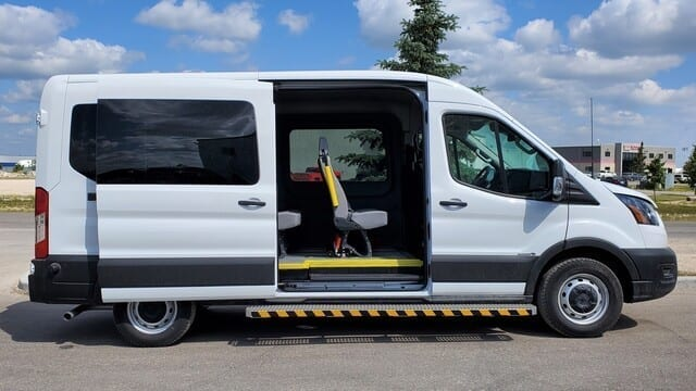 MoveMobility Ford Transit wheelchair accessible van with seats and wheelchair positions for mobility transportation