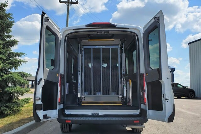 Rear hydraulic BraunAbility wheelchair lift in Ford Transit wheelchair van at MoveMobility