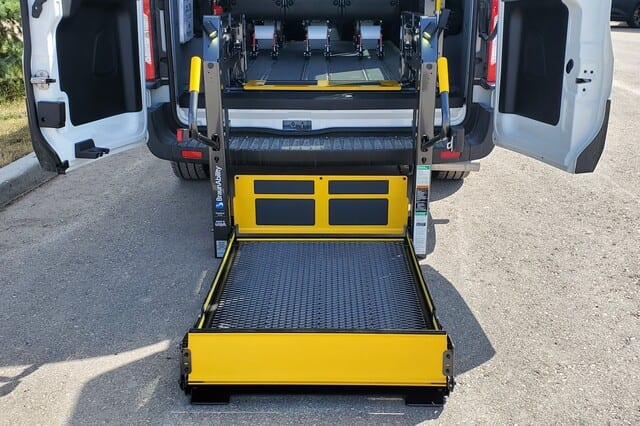 BraunAbility rear access hydraulic lift in Ford Transit MoveMobility