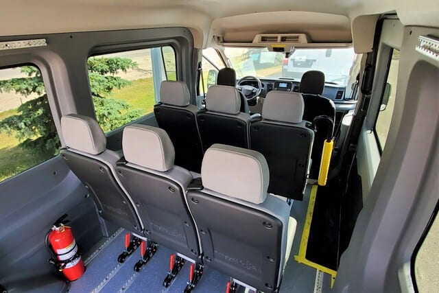 wheelchair van interior with removeable seats, autofloor, passenger grab handle and wheelchair positions
