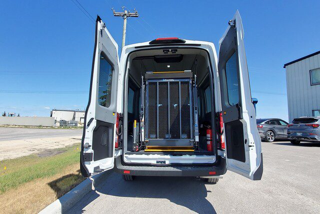 Ford Transit with rear doors open showing wheelchair lift