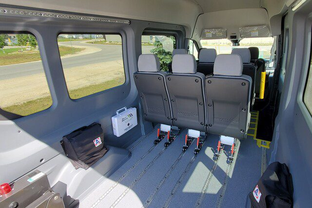 interior of ford transit wheelchair van with removeable seats and a floor track system